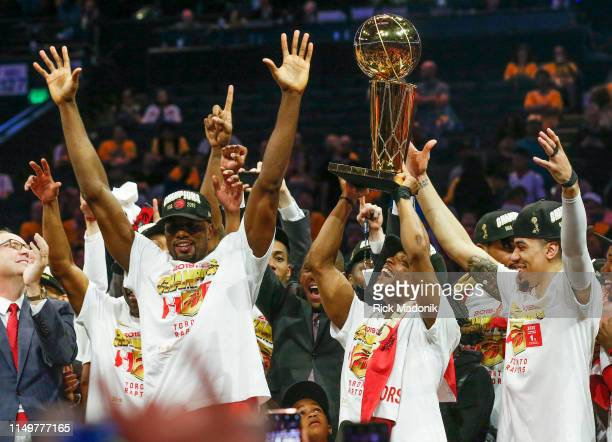 Toronto Raptors guard Kyle Lowry hoists the trophy with Toronto Raptors center Serge Ibaka and Toronto Raptors guard Danny Green right Toronto...
