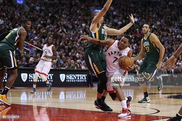 TORONTO ON JANUARY 5 Toronto Raptors guard Kyle Lowry is fouled by Utah Jazz guard Dante Exum as the Toronto Raptors beat the Utah Jazz 10193 at Air...