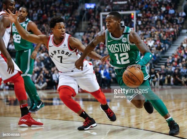 TORONTO ON APRIL 4 Toronto Raptors guard Kyle Lowry keeps a close eye on Boston Celtics guard Terry Rozier in the 1st quarter as the Toronto Raptors...
