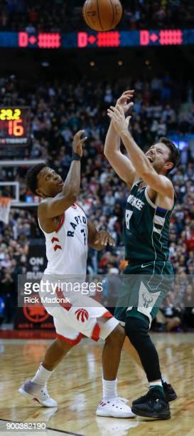 Toronto Raptors guard Kyle Lowry knocks the ball loose from Milwaukee Bucks guard Matthew Dellavedova . Toronto Raptors vs Milwaukee Bucks in 2ndhalf...