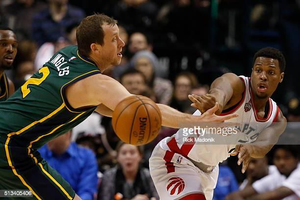Toronto Raptors guard Kyle Lowry passes the ball past Utah Jazz forward Joe Ingles . Toronto Raptors vs Utah Jazz in 2nd half action of NBA regular...