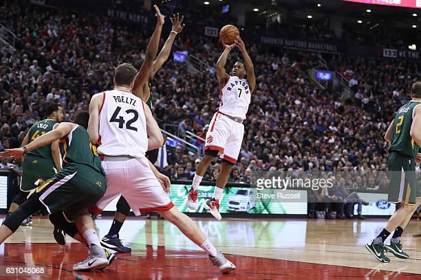 TORONTO ON JANUARY 5 Toronto Raptors guard Kyle Lowry puts up a shot as the Toronto Raptors beat the Utah Jazz 10193 at Air Canada Centre in Toronto...