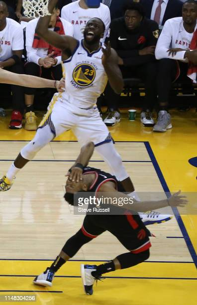 OAKLAND CA JUNE 5 Toronto Raptors guard Kyle Lowry reacts after taking a Golden State Warriors forward Draymond Green elbow on the chin as the...