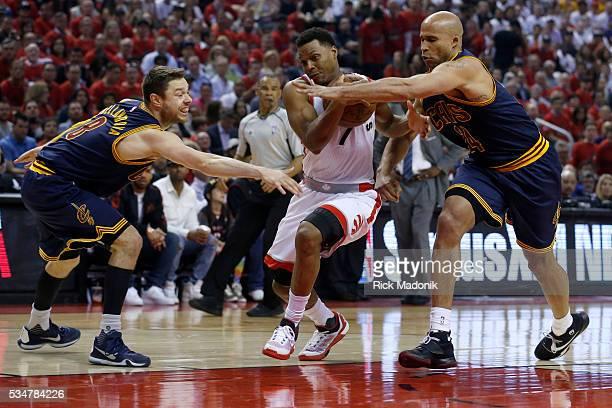 Toronto Raptors guard Kyle Lowry splits the d of Cleveland Cavaliers guard Matthew Dellavedova and Cleveland Cavaliers forward Richard Jefferson...
