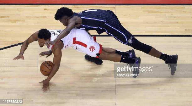 TORONTO ON APRIL 16 Toronto Raptors guard Kyle Lowry steals the ball and then gets fouled by Orlando Magic forward Jonathan Isaac as the Toronto...