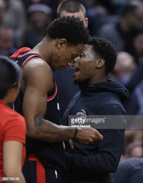 TORONTO DECEMBER 15 Toronto Raptors guard Kyle Lowry talks with DeMar DeRozan during a time out as the Toronto Raptors beat the Brooklyn Nets at the...