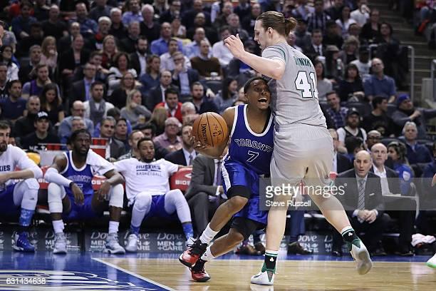 Toronto Raptors guard Kyle Lowry tries to sneak by Boston Celtics center Kelly Olynyk as the Toronto Raptors wearing their throw back Toronto Huskies...