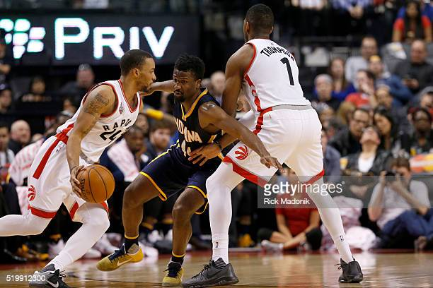 Toronto Raptors guard Norman Powell moves the ball as Toronto Raptors forward Jason Thompson sets a pick on Indiana Pacers forward Solomon Hill...