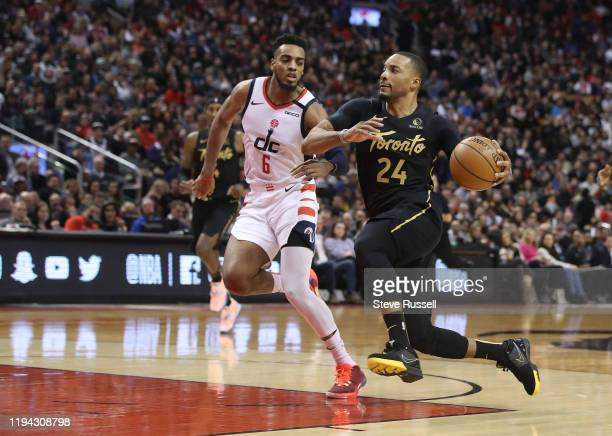 TORONTO ON JANUARY 17 Toronto Raptors guard Norman Powell sprints to the basket against Washington Wizards guard Troy Brown Jr as the Toronto Raptors...