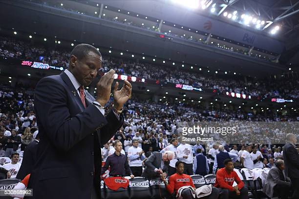 Toronto Raptors head coach Dwane Casey applauds during player intros as the Toronto Raptors play the Miami Heat in game five of their Eastern...
