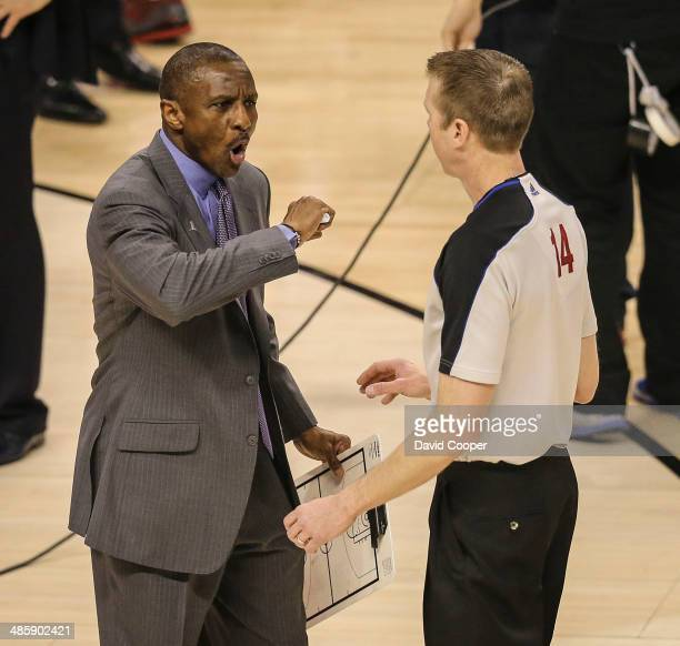 TORONTO ON APRIL 19 Toronto Raptors head coach Dwane Casey has a heated talk with referee Ed Malloy during the game The Brooklyn Nets defeated the...