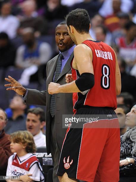 Toronto Raptors head coach Dwane Casey speaks with Toronto Raptors point guard Jose Calderon during thirdquarter action against the Washington...