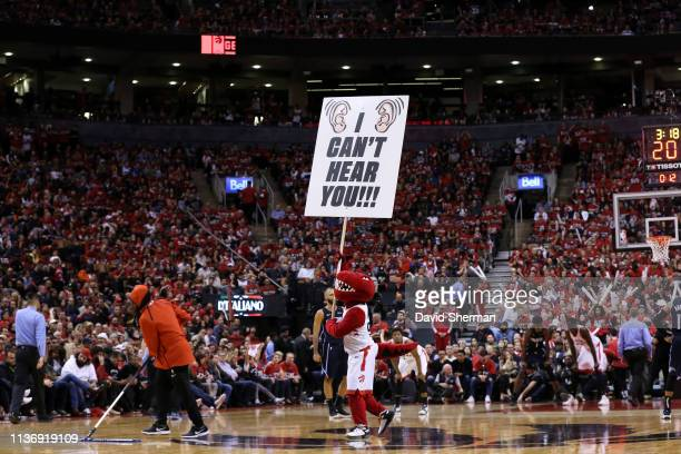 Toronto Raptors mascot excites the crowd during Game One of Round One of the 2019 NBA Playoffs on April 13 2019 at the Scotiabank Arena in Toronto...