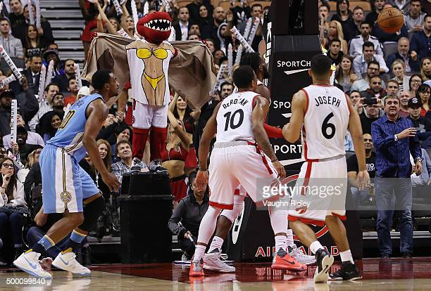 Toronto Raptors mascot The Raptor attempts to distract a free throw by Randy Foye the Denver Nuggets during an NBA game at the Air Canada Centre on...