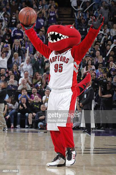 Toronto Raptors mascot The Raptor excites the crowd during the game between the Portland Trail Blazers and Sacramento Kings on March 1 2015 at Sleep...