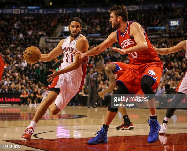 TORONTO ON DECEMBER 13 Toronto Raptors new point guard Greivis Vasquez drives in the paint around Philadelphia 76ers center Spencer Hawes late in the...