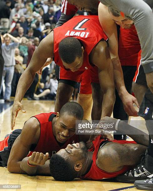 Toronto Raptors players DeMar DeRozan Kyle Lowry and Amir Johnson celebrate a 109108 win over the Dallas Mavericks in overtime at the American...