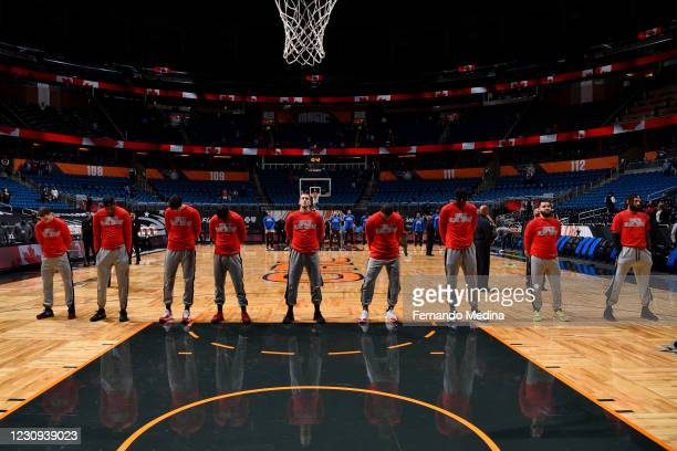 Toronto Raptors players stand for the national anthem during the game against the Orlando Magic on February 2, 2021 at Amway Center in Orlando,...