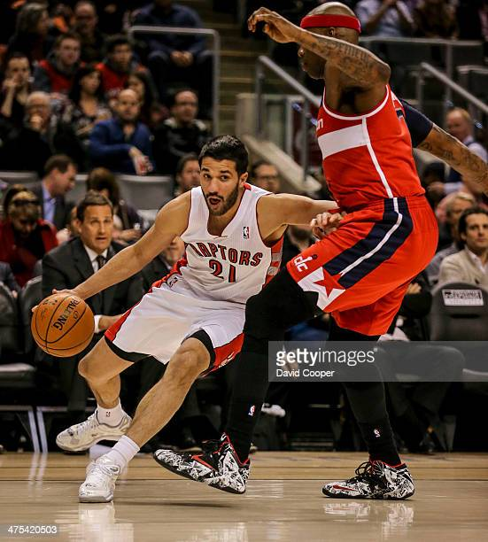 TORONTO ON FEBRUARY 27 Toronto Raptors point guard Greivis Vasquez looks to pass the ball as he cut under Washington Wizards power forward Al...