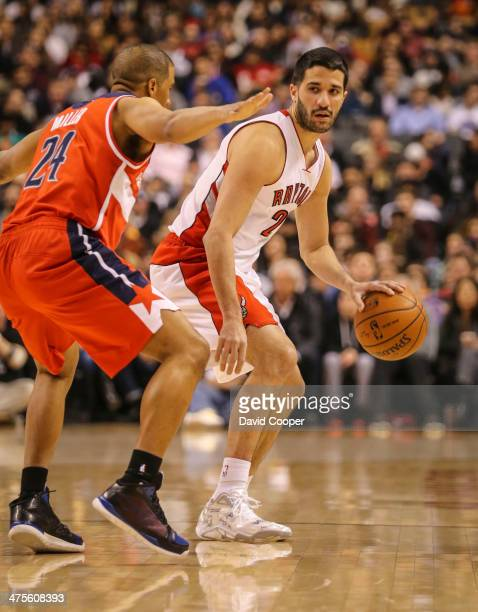 Toronto Raptors point guard Greivis Vasquez looks to pass while being guarded by Washington Wizards point guard Andre Miller during the game between...
