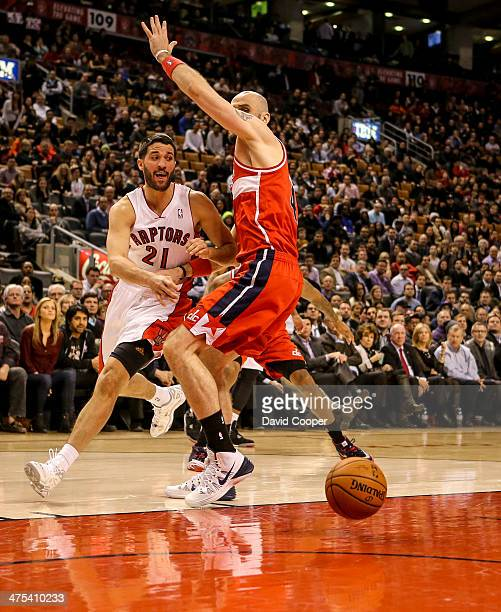 TORONTO ON FEBRUARY 27 Toronto Raptors point guard Greivis Vasquez tires to pass to Toronto Raptors power forward Tyler Hansbrough under the basket...