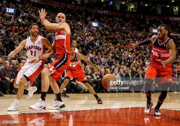 TORONTO ON FEBRUARY 27 Toronto Raptors point guard Greivis Vasquez tries to pass to Toronto Raptors power forward Tyler Hansbrough under the basket...