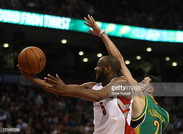 Toronto Raptors point guard John Lucas gets the ball past New Orleans Hornets point guard Greivis Vasquez as the Toronto Raptors beat the New Orleans...