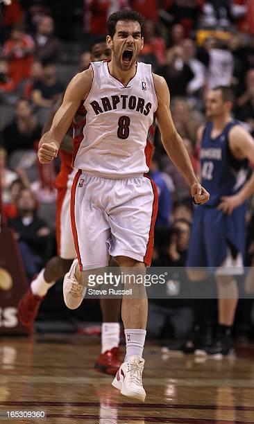 Toronto Raptors point guard Jose Calderon celebrates Amir Johnson's key basket as the Toronto Raptors break their 13game losing streak with a 111100...