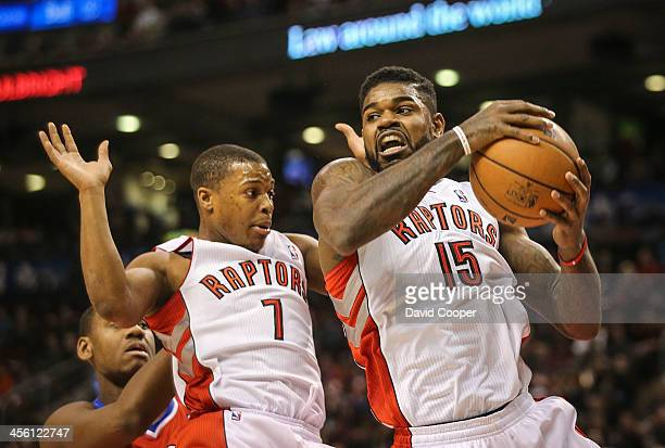 TORONTO ON DECEMBER 13 Toronto Raptors point guard Kyle Lowry backs off as Toronto Raptors power forward Amir Johnson come down with the defensive...