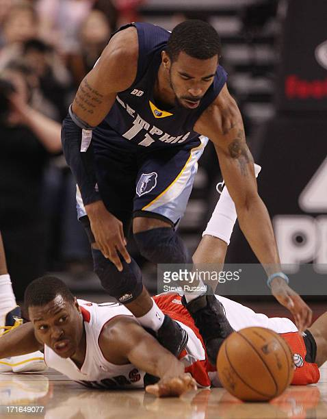 Toronto Raptors point guard Kyle Lowry dives for a loose ball in front of Mike Conley as the Toronto Raptors play the Memphis Grizzlies at the Air...