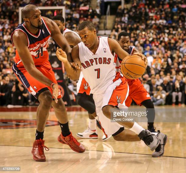 Toronto Raptors point guard Kyle Lowry heads around Washington Wizards small forward Chris Singleton on the way to the basket during the game between...