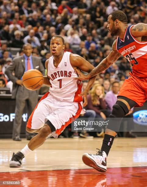 TORONTO ON FEBRUARY 27 Toronto Raptors point guard Kyle Lowry heads for the hoop past Washington Wizards power forward Trevor Booker during the game...
