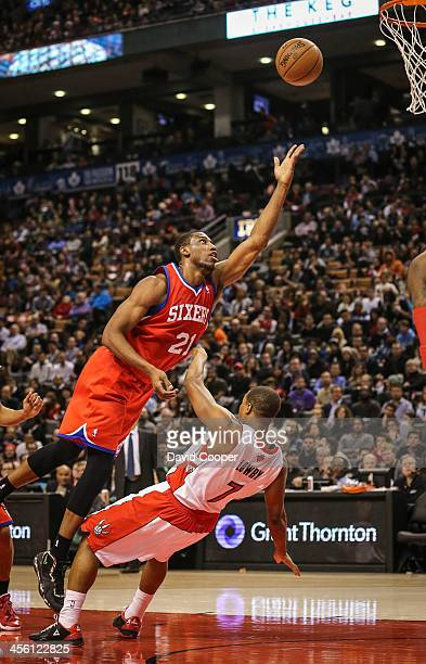 TORONTO ON DECEMBER 13 Toronto Raptors point guard Kyle Lowry receives an offensive foul from Philadelphia 76ers power forward Thaddeus Young as the...