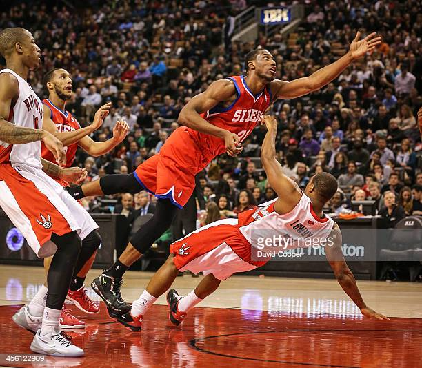 Toronto Raptors point guard Kyle Lowry receives an offensive foul from Philadelphia 76ers power forward Thaddeus Young as the Philadelphia 76ers take...