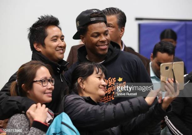 TORONTO ON OCTOBER 4 Toronto Raptors point guard Kyle Lowry smiles for photos after the meal that he and his wife Ayahna will distribute 325 meals to...