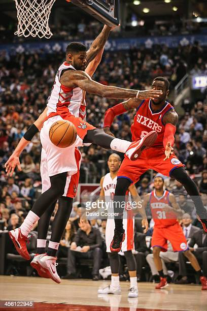 TORONTO ON DECEMBER 13 Toronto Raptors power forward Amir Johnson guards Philadelphia 76ers shooting guard Tony Wroten as the Philadelphia 76ers take...