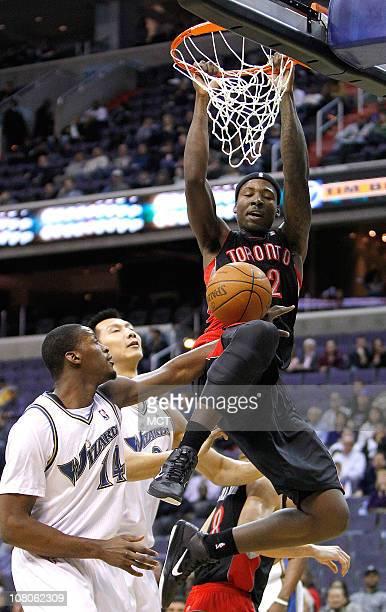 Toronto Raptors power forward Ed Davis slam dunks over Washington Wizards small forward Al Thornton during their game played at the Verizon Center in...