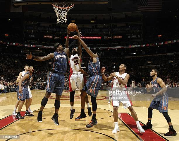 Toronto Raptors power forward Ed Davis splits defense during the game against the Charlotte Bobcats on March 13 2011 at the Air Canada Centre in...