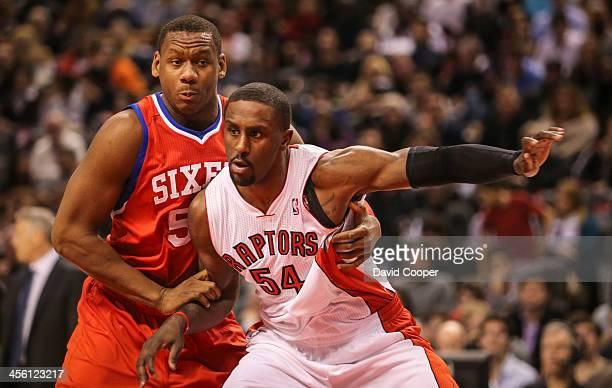 Toronto Raptors power forward Patrick Patterson boxes out Philadelphia 76ers power forward Lavoy Allen as the Philadelphia 76ers take on theToronto...