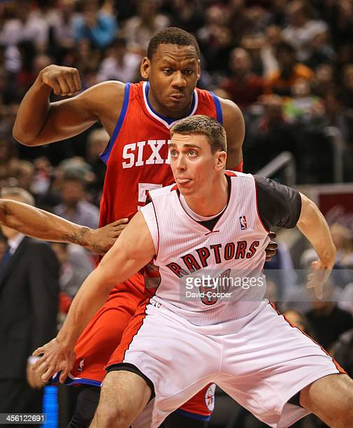 Toronto Raptors power forward Tyler Hansbrough boxes out Philadelphia 76ers power forward Lavoy Allen during his first game as a Raptor as the...