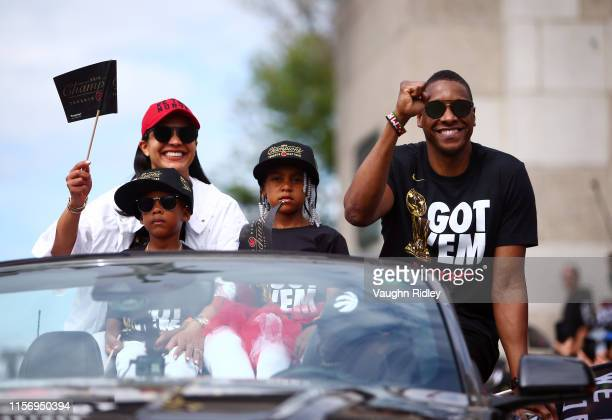 Toronto Raptors President Masai Ujiri and family wave during the Toronto Raptors Victory Parade on June 17, 2019 in Toronto, Canada. The Toronto...