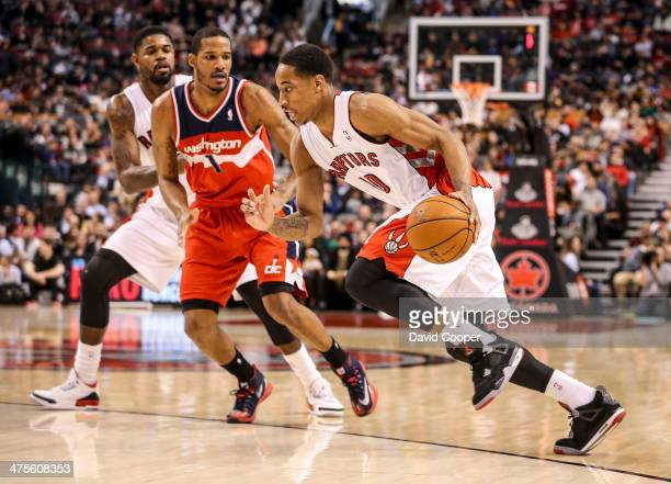 Toronto Raptors shooting guard DeMar DeRozan drives to the basket past Washington Wizards small forward Trevor Ariza during the game between the...
