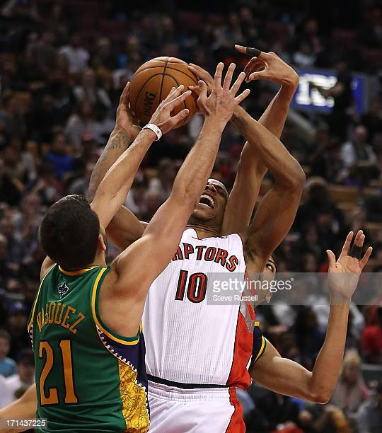 Toronto Raptors shooting guard DeMar DeRozan is fouled by New Orleans Hornets point guard Greivis Vasquez as the Toronto Raptors beat the New Orleans...