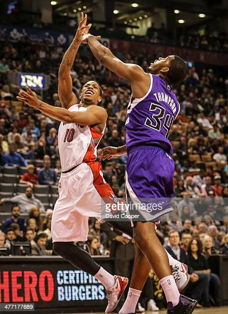TORONTO ON MARCH 7 Toronto Raptors shooting guard DeMar DeRozan looks past Sacramento Kings power forward Jason Thompson towards the basket during...