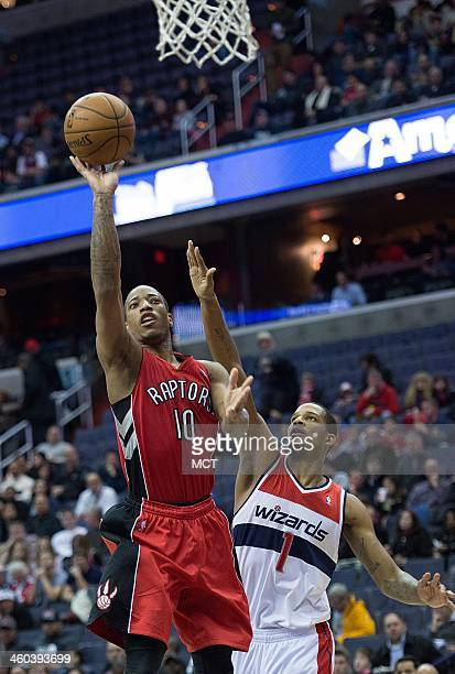 Toronto Raptors shooting guard DeMar DeRozan shoots over Washington Wizards small forward Trevor Ariza during the first half of their game played at...
