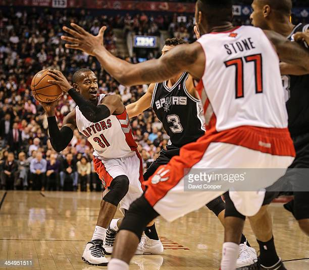 Toronto Raptors shooting guard Terrence Ross looks to pass under the hoop as the Toronto Raptors take on the San Antonio Spurs at the Air Canada...