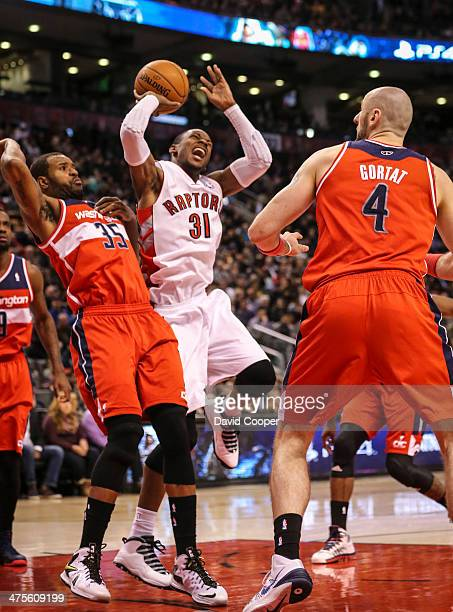 TORONTO ON FEBRUARY 27 Toronto Raptors small forward Terrence Ross has a painful landing in the paint against Washington Wizards power forward Trevor...