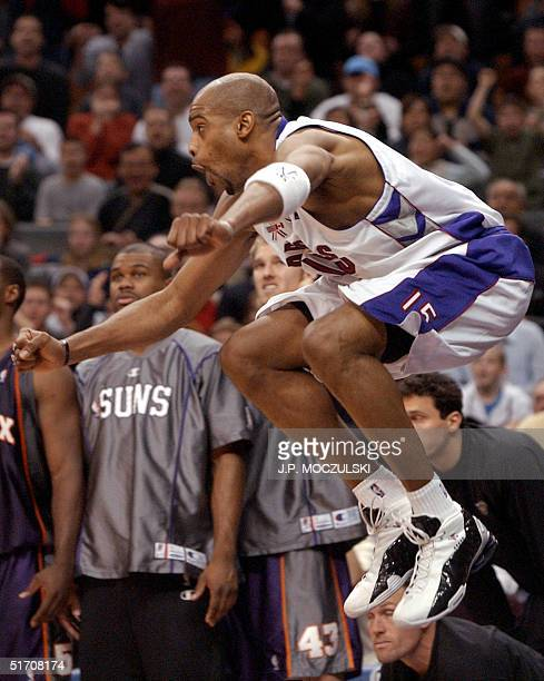 Toronto Raptors' Vince Carter celebrates after scoring what appeared to be a game winning basket against the Phoenix Suns with three seconds left on...