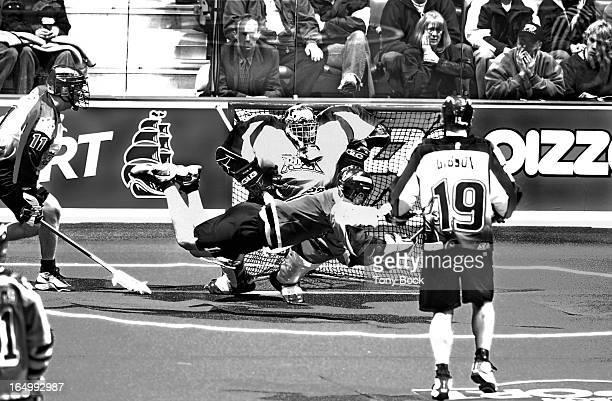 1/26/2002 TORONTOROCK Toronto Rock beat Rochester Nighthawks 149 D'Arcy Sweet flies across Bob Watson's goal on an unsuccessful attempt TONY...