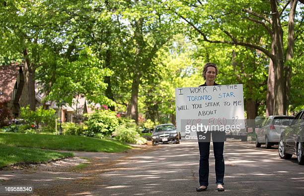 Toronto Star columnist Catherine Porter carries a sign inviting residents to speak to her regarding Toronto Mayor Rob Ford Porter was in areas of...